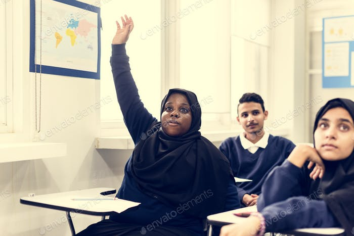 Diverse Muslim children studying in a classroom