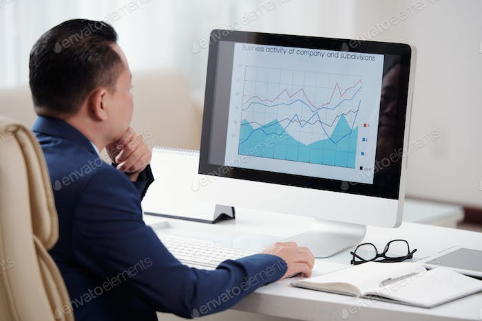 Businessman analyzing chart