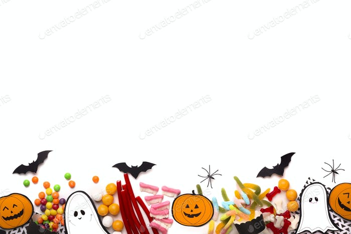 Happy Halloween background with candies composition and copy space