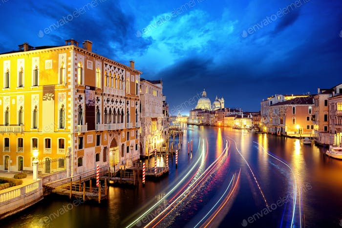 The Grand Canal and Basilica Santa Maria della Salute during night with gondolas, Venice, Italy