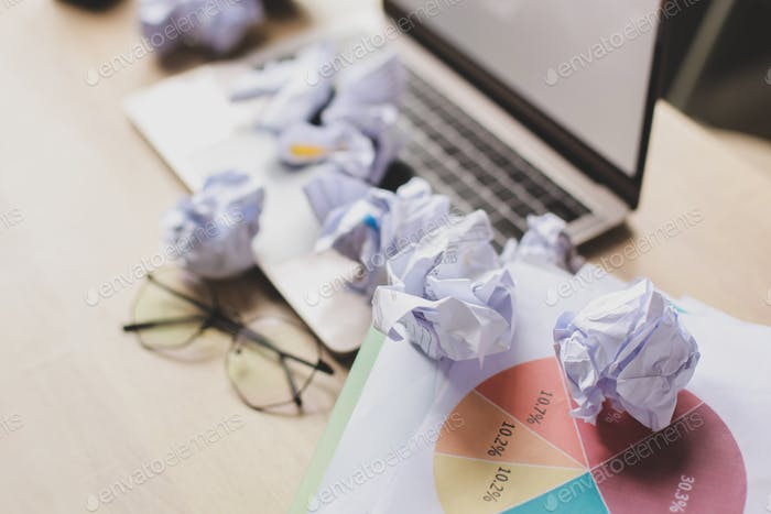 Crumpled papers on office desk