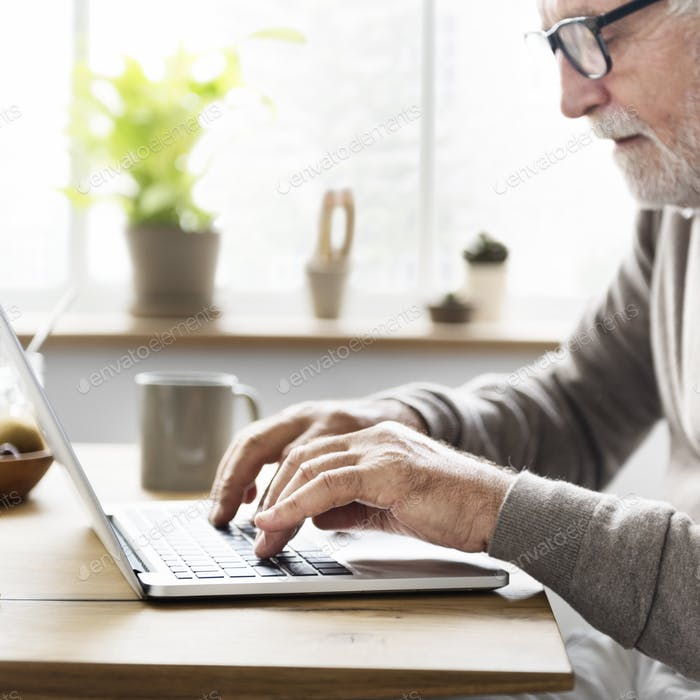 Senior Adult Using Laptop Thinking Concept