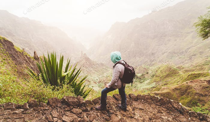 Santo Antao Island, Cape Verde. Traveler with backpack on hike enjoying view of surreal Xo Xo valley