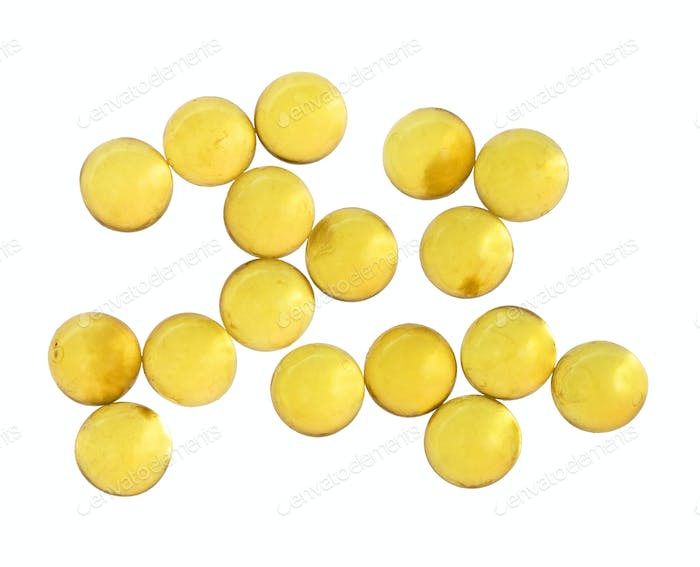 top view of capsules with oil isolated on white