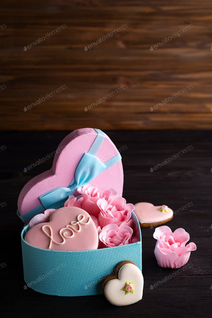 romantic decoration St valentine's day concept with box heart and pink rose on dark wooden