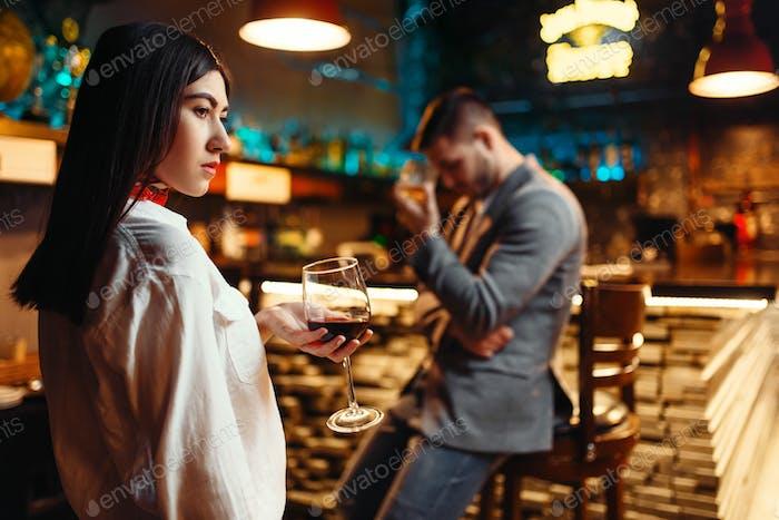 Couple in quarrel, husband and wife in nightclub