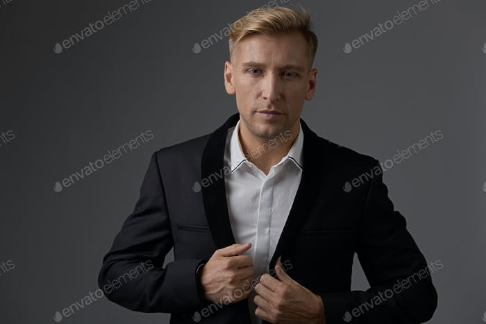 Close-up businessman portrait with hands crossed