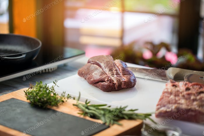 Raw meat and knife