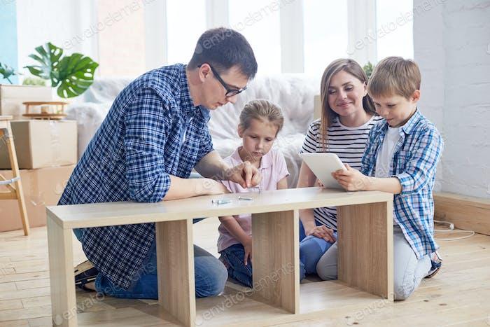 Young Family Assembling Wardrobe