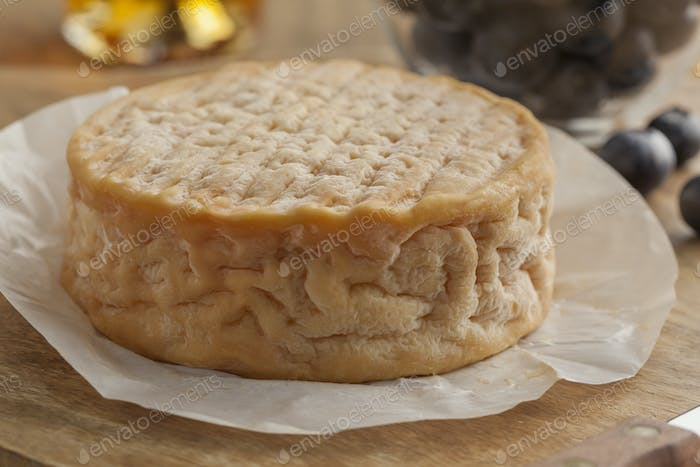 Whole Epoisses cheese close up