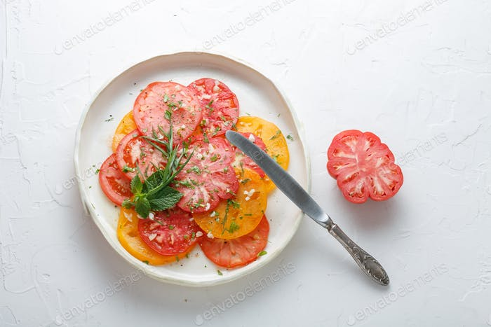 Tomato sliced on a plate. Top view