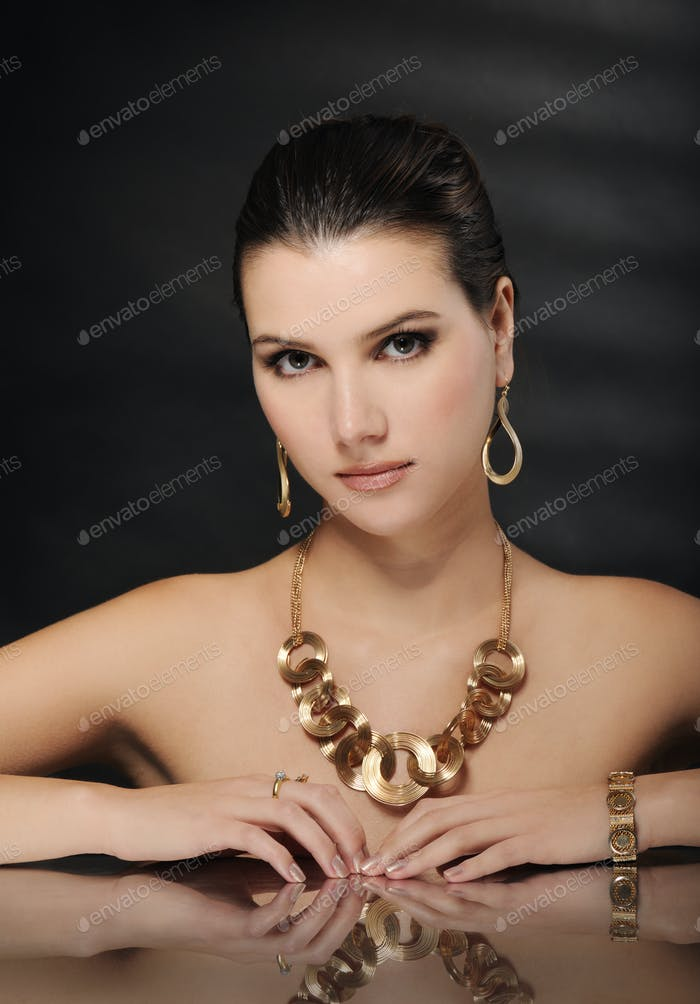 beautiful woman in golden jewelry