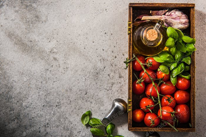 Cherry tomatoes with fresh basil and olive oil