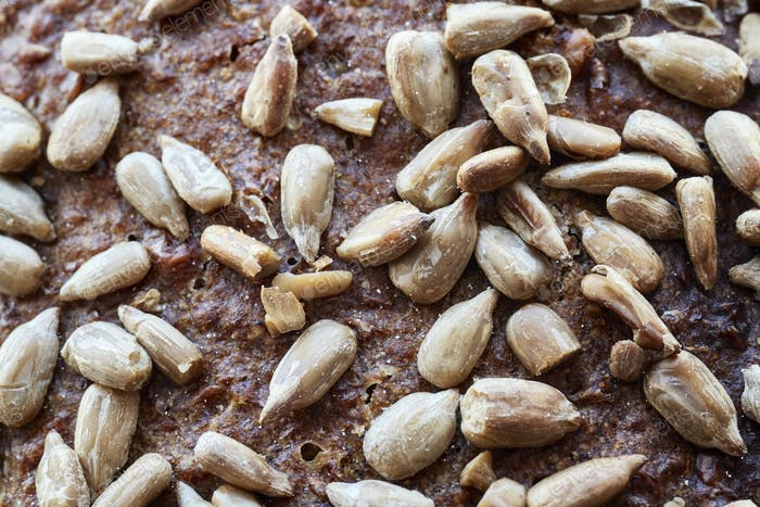 Whole wheat bread crust with sunflower seeds.