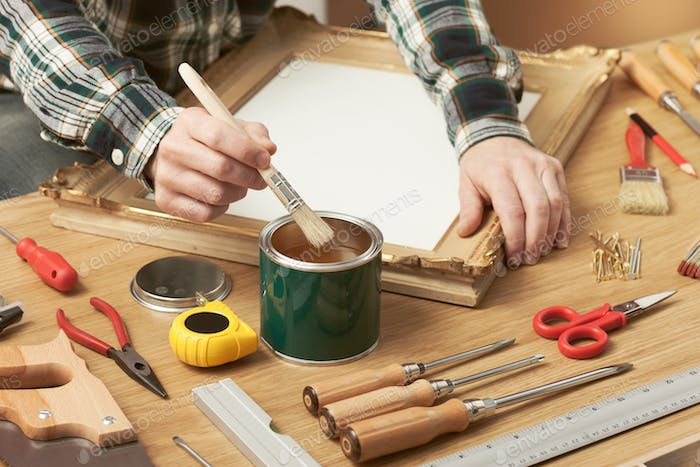 Thumbnail for Decorator varnishing a wooden frame