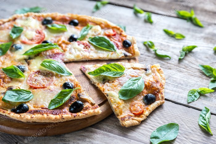 Cut pizza on the wooden board
