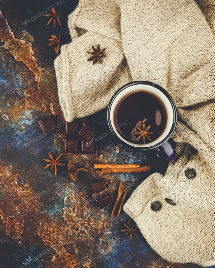 Hot winter tea with cinnamon stick and chocolate