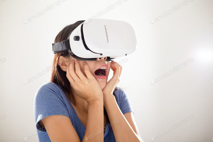 Scared Woman wearing VR device