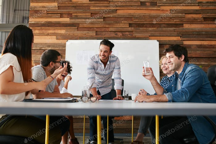 Happy young people having a business meeting
