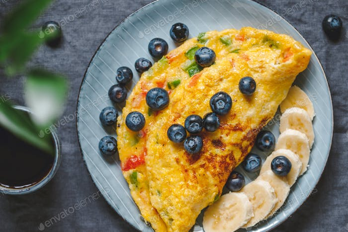 Top view on vegetarian omelette with red and green bell peppers