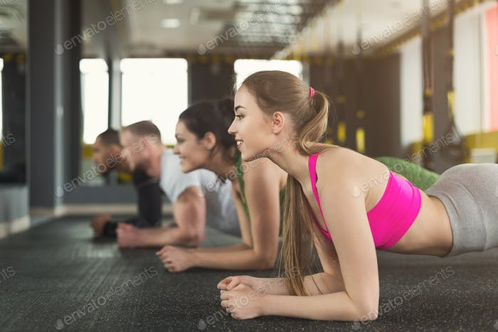 Fitness group plank training indoors