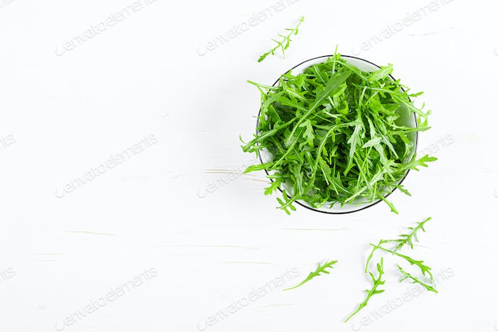 Fresh arugula or rocket leaves salad, rucola, top view