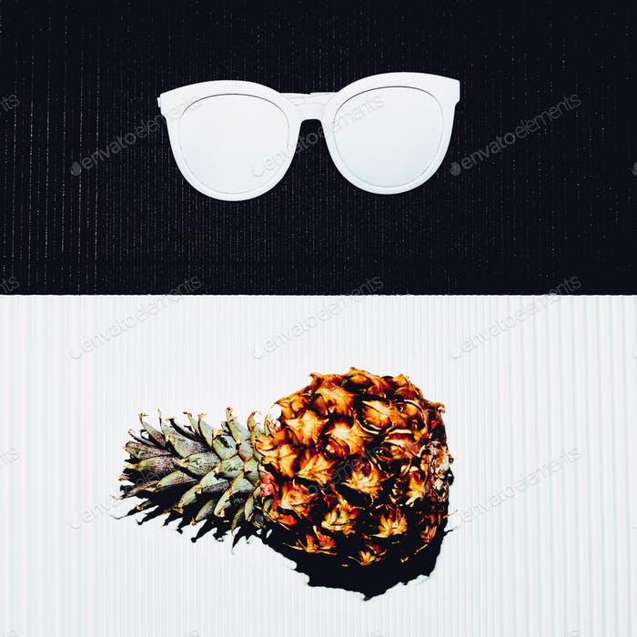 Pineapple and sunglasses. White black minimal