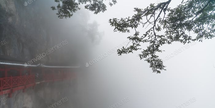 Path on a cliff of Tianmen mountain covered in fog