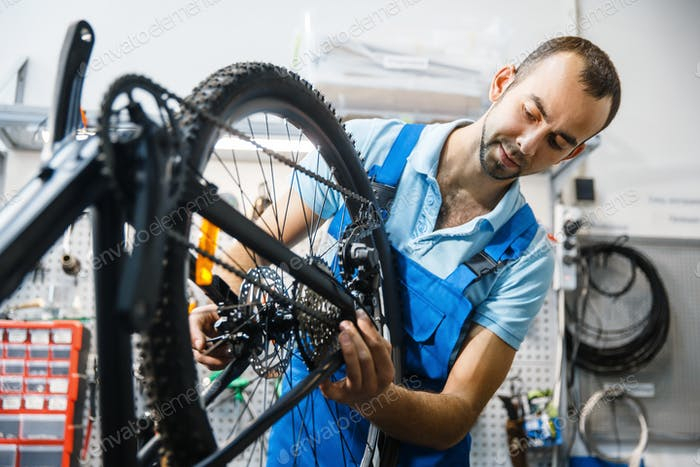 Bicycle assembly in workshop, chain installation