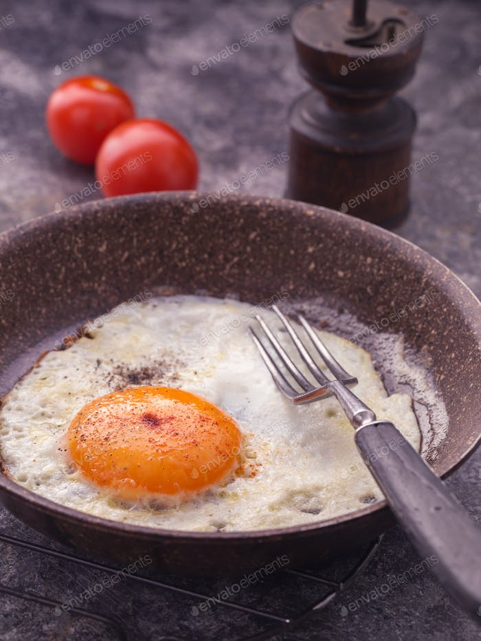 Fried egg on frying pan closeup