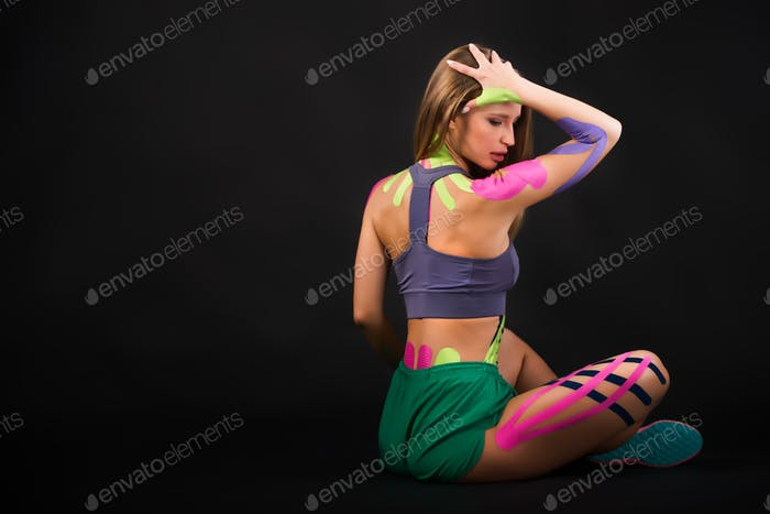 Portrait of a motivated woman, alternative kinesio therapy