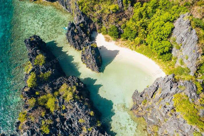 El Nido Palawan National Park. Hidden lagoon and lime stone rocks. White beach on tourist routes in