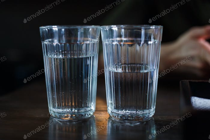 Two glasses with vodka on a table in a restaurant