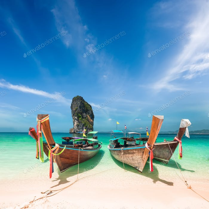 Amazing tropical landscape with Thai traditional boat. Thailand