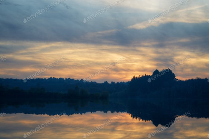 Moody atmosphere at sunset over a lagoon