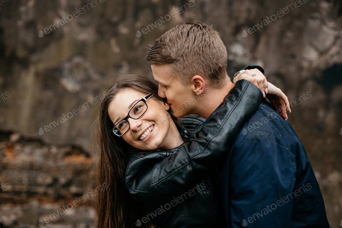 A young couple in love hugging and kissing. A young couple in love hugging and kissing.