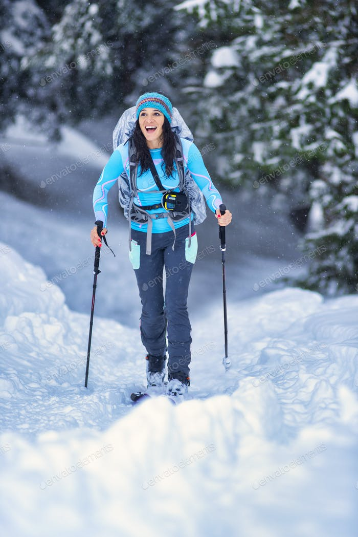 Girl practicing ski touring in the woods
