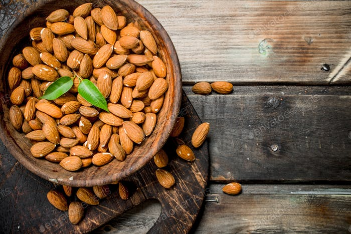 Almonds in bowl .