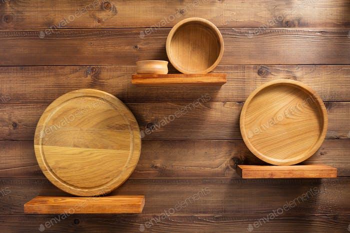 wooden kitchenware at shelf