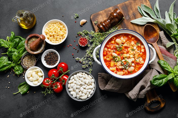 Cooking pasta e fagioli soup with chicken meat and vegetables, italian cuisine