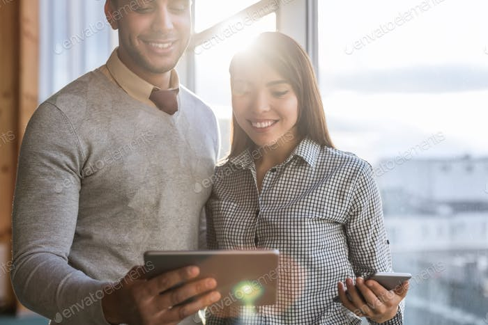 Mix Race Business Man Woman Using Cell Smart Phone Stand In Front Panoramic Window Happy Smiling