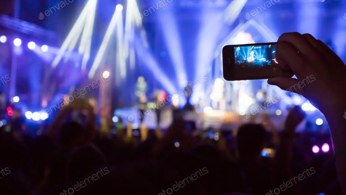 Fan taking photo of concert