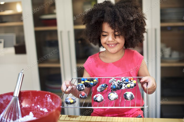 Little Girl Baking Homemade Cookie Hobby Concept