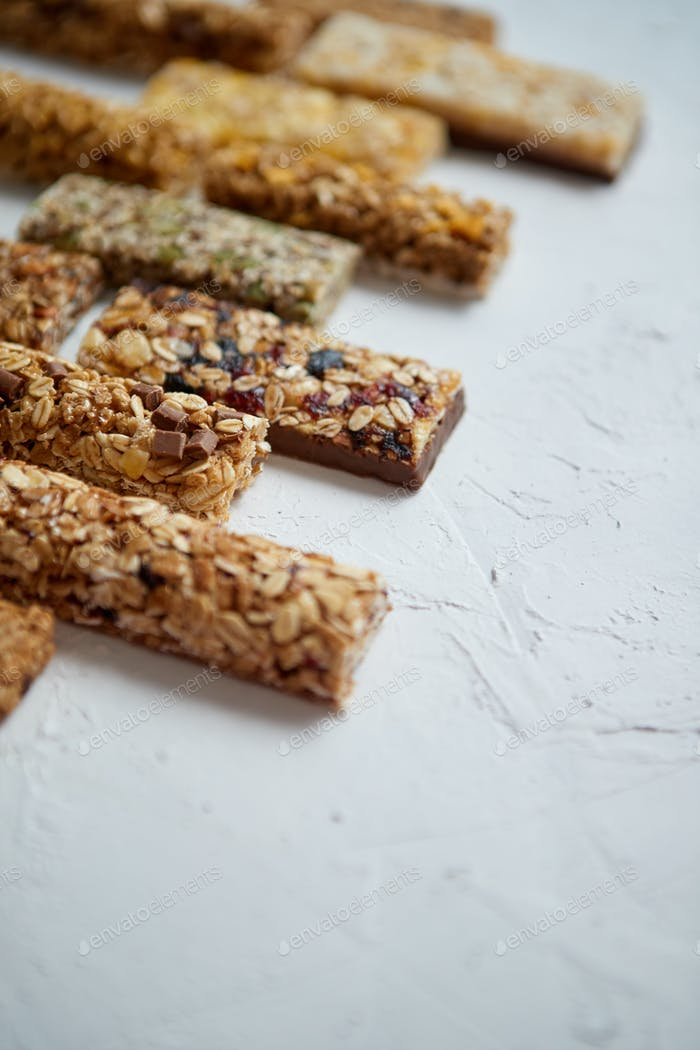 Thumbnail for Row of mixed gluten free granola cereal energy bars. With dried fruits and nuts