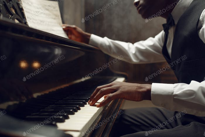 Black pianist, jazz performer on the stage
