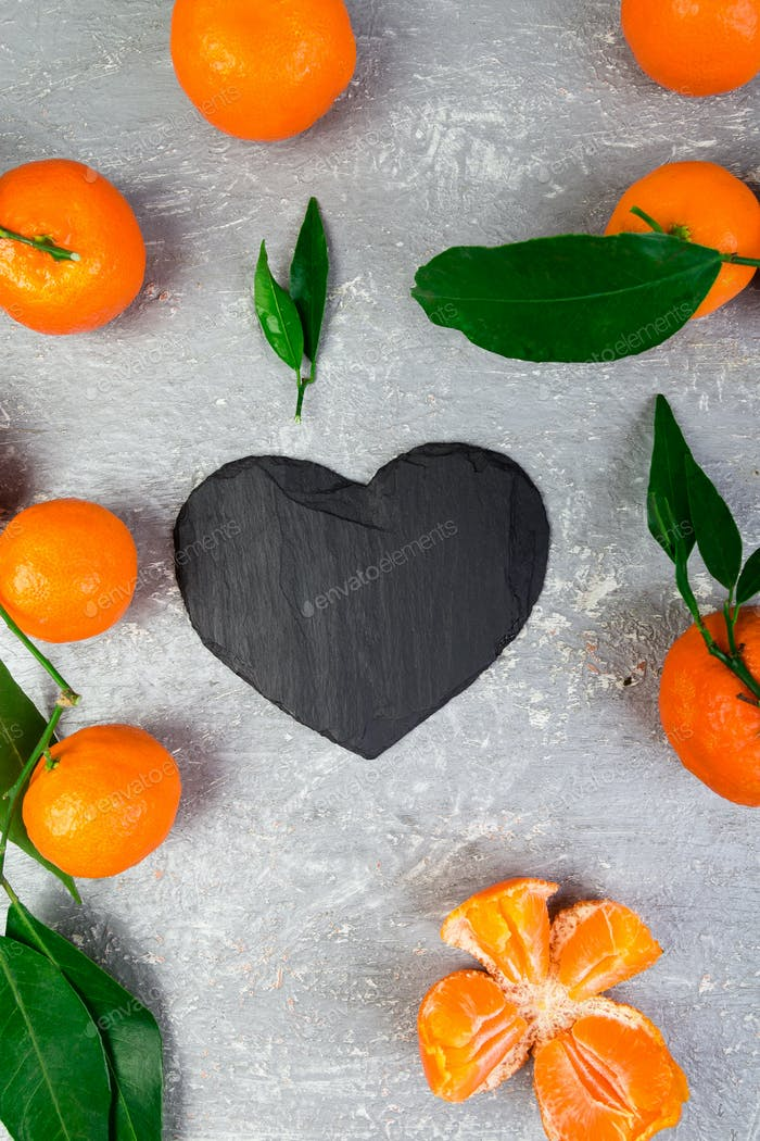 Tangerine around with black slate heart shaped.
