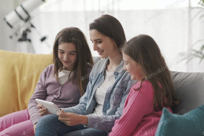 Happy family watching videos online together