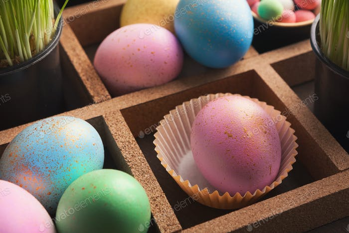 Easter eggs in wooden container