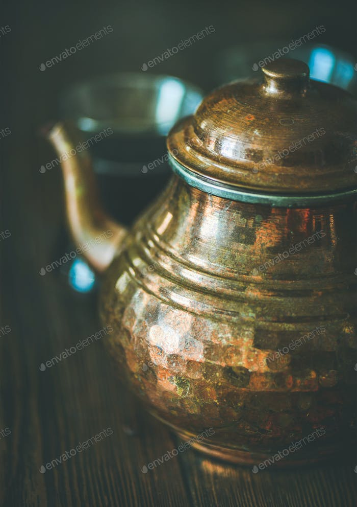 Oriental Middle Eastern tea pot and black tea in glasses