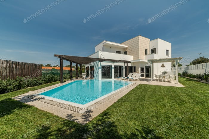 Modern house with garden swimming pool and wooden pergula